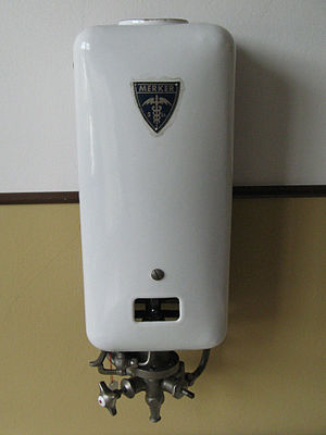 Pilot light - Merker gas-fired water heater from the 1930s, with pilot light clearly visible through the aperture in the front cover. The large opening allowed for the manual lighting of the pilot light by a lit match or taper