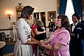 Michelle Obama greets guests in the Blue Room of the White House, May 2011.jpg