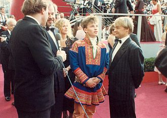 Mikkel Gaup - Mikkel Gaup (in traditional Sámi Gákti costume) and Nils Gaup (right) on the red carpet at the 60th Annual Academy Awards