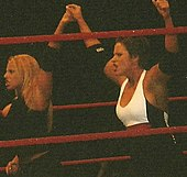fc5eff711c Stratus (left) along with Molly Holly during a WWE house show in October  2004
