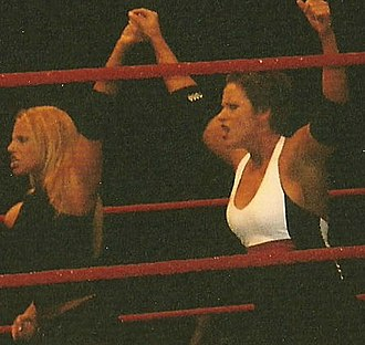 Molly Holly - Holly (right) along with Trish Stratus during a WWE house show in October 2004