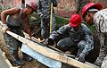 Mongolian and U.S. armed forces engineers pour concrete to form the base of a handicap-accessible ramp at a school during Khaan Quest 2013 in Ulaanbaatar, Mongolia, July 24, 2013 130724-M-MG222-006.jpg