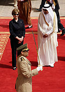 Mrs. Laura Bush and President Bush are greeted by Saudi delegation members.jpg