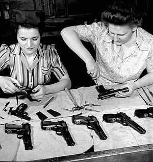 Arms industry - Workers assemble Browning-Inglis Hi-Power pistols at the John Inglis munitions plant, Canada, April 1944