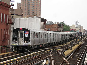 M (New York City Subway service) - A train made of R160 cars in M service entering Hewes Street, bound for Middle Village–Metropolitan Avenue.