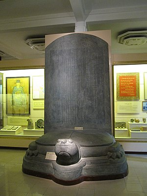 Nguyễn Trãi - Vĩnh Lăng stele (replica). Stone, erected in the 6th year of Thuận Thiên reign (1433). Early Lê dynasty, ancient capital of Lam Kinh, Thanh Hóa Province, central Vietnam. Inscribed by Nguyễn Trãi. Commemorative element. Inscription showed on biography of Lê Lợi, leader of Lam Son uprising (1418-1427) against Ming invaders from China, from beginning to final victory and him becoming the first king of the Early Lê dynasty in 1428. This stele is also one of typical stone sculptures of Vietnam fine art in the 15th century. National Museum of Vietnamese History, Hanoi.