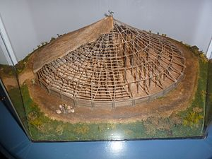 Navan Fort - Small-scale reconstruction of the circular building which once sat on the site of the mound