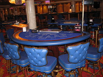 Three Card Poker - A Three Card Poker table in a casino aboard the Norwegian Dawn cruise ship