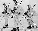 Norwegian Winter War volunteer soldiers in white snow overalls