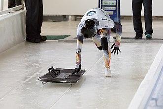 Skeleton (sport) - Nozomi Komuro pushes off at the start