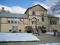 The Oregon Public Library in Oregon, Illinois, U.S.A. is an example of Arts and Crafts in a Carnegie Library.
