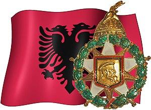 Order of Skanderbeg (1990–) - Order of Skanderbeg insignia, shown with the Albanian Flag