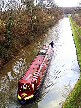 Oxford Canal - A canal boat on the canal near Brinklow on the long stretch between Coventry and Rugby.