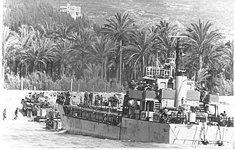 1982 Lebanon War - Israeli armored vehicles disembark from a landing craft during an amphibious landing
