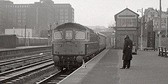 Kensington (Olympia) station - Image: PO Workers train Olympia 1968