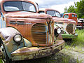 Pair of rusty old Reo Speedwagon trucks (3661907760).jpg
