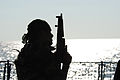 Pakistan Navy Special Service Group member silhouetted aboard Pakistan Navy Ship PNS Babur.jpg