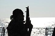 Pakistan Navy Special Service Group member silhouetted aboard Pakistan Navy Ship PNS Babur