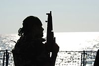 Pakistan Navy Special Service Group member silhouetted aboard Pakistan Navy Ship PNS Babur