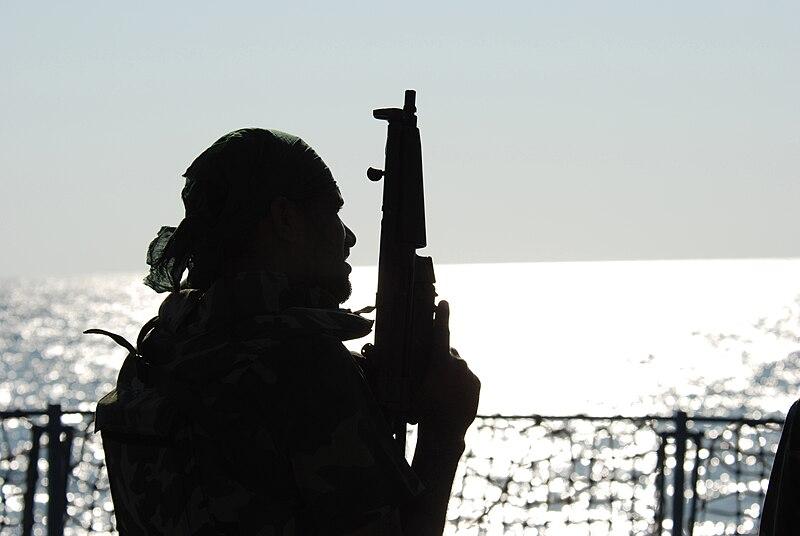 Pakistan Navy Special Service Group member silhouetted aboard Pakistan Navy Ship PNS Babur.jpg