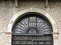 Palazzo Perolari-Malmignati, retro, portale, dettaglio lunetta (Lendinara).jpg