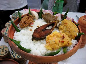 Ilish - Panta Ilish - a traditional platter of congee with fried Ilish slice, supplemented with dried fish (Shutki), pickles (Achar), dal, green chillies and onion - is a popular serving for the Pohela Boishakh festival.