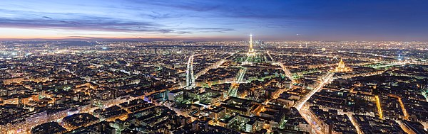 Panoramic view over Paris, at dusk, from the top of the Tour Montparnasse.