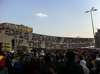 Ash-shab yurid isqat an-nizam - English version of the slogan at rally in Tahrir Square.