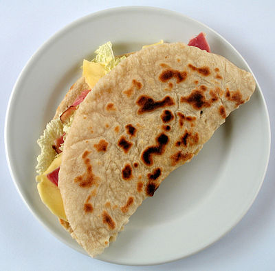 A piadina, a dish characteristic of the Italian region of Romagna and of its enclave of San Marino Piadina.jpg