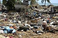 Man walking around in Ruins after Tsunami.
