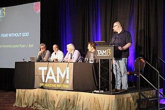 Derek Colanduno - Colanduno (standing) in 2015, on the podcast panel at TAM13