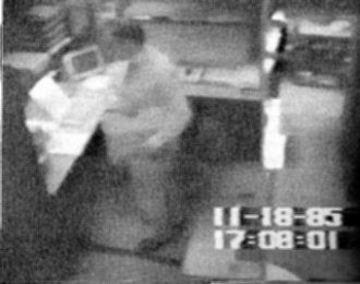 Jonathan Pollard - Surveillance video frame of Pollard in the act of stealing classified documents