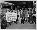 Prayer pilgrimage attendees holding an ILGWU sign in front of their bus (5279610992).jpg