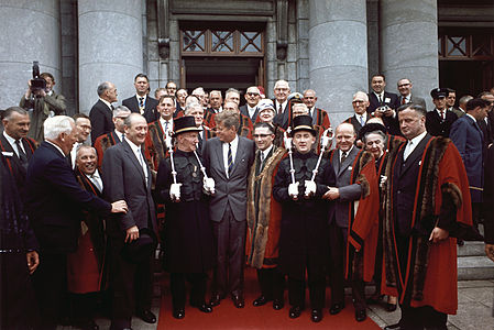 President Kennedy with Lord Mayor Sean Casey, mace bearers, members of the Cork Corporation, U. S. Ambassador to Ireland Matthew McCloskey, others. Cork, Ireland, City Hall.jpg