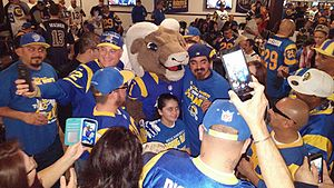 Rampage (mascot) - Rampage posing with fans of the Rams shortly after the team announced its relocation back to Los Angeles in 2016