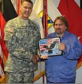 Roland Acker, a logistics specialist with the Theater Logistic Support Center-Europe, accepts the hero of the week award from U.S. Army Maj. Gen. John R. O'Connor 130808-A-LN304-024.jpg