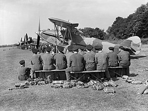 RAF Halton - Apprentices of No. 1 School of Technical Training listen to a lecture on servicing aircraft in the field, in front of a line of instructional airframes, during the early 1940s