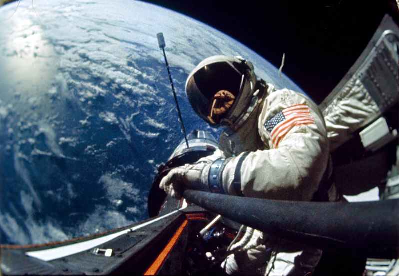 Buzz Aldrin in space, with the Gemini 12 spacecraft and Earth