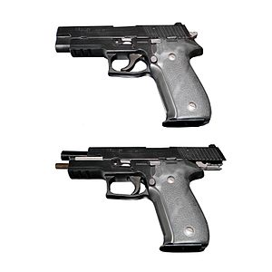 Slide stop - A P226 with breech closed (top) and opened (bottom). On the bottom view, the slide is locked in place by the slide stop.
