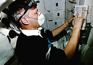 Corrective maintenance - Inflight maintenance checklist procedure before starting waste collection system repair on board the Atlantis shuttle.