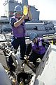 Sailors inspect fuel during a replenishment-at-sea. (8407485673).jpg