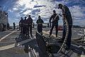 Sailors strike down mooring lines aboard USS McCampbell. (11996692173).jpg