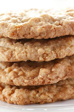 Salted oatmeal white chocolate cookies stacked.