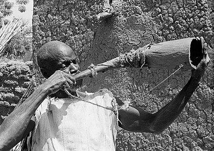 samo man playing war horn
