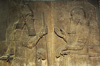 Sargon II - Sargon II (left) faces a high-ranking official, possibly Sennacherib his son and crown prince. 710-705 BCE. From Khorsabad, Iraq. The British Museum, London