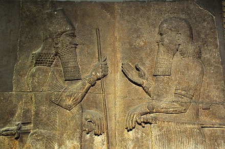 Sargon II (left) faces a high-ranking official, possibly Sennacherib his son and crown prince. 710-705 BCE. From Khorsabad, Iraq. The British Museum, London Sargon II (left) faces a high-ranking official, possibly Sennacherib his son and crown prince. 710-705 BCE. From Khorsabad, Iraq. The British Museum, London.jpg