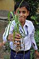 School Student Holds Polianthes tuberosa - Ramakrishna Mission Ashrama - Sargachi - Murshidabad 2014-11-11 8972.JPG