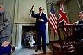 Secretary Kerry Raises the Benjamin Franklin Medal for Leadership Upon Receiving It in London (30573395492).jpg