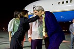 Secretary Kerry is Presented With a Traditional Lei from a Filipino Protocol Official at the Villamor Airport in Manila (28485481251).jpg