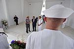 Secretary of Defense Leon E. Panetta, center, talks with U.S. National Park Service Ranger Daniel Martinez, center left, and Navy Adm. Cecil Haney while visiting the USS Arizona Memorial at Pearl Harbor, Hawaii 120309-D-NI589-042.jpg